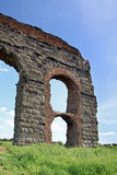 Stone arches of ancient Roman aqueduct, Rome Stock Image