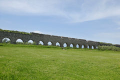 Stone arches of ancient Roman aqueduct. Rome Royalty Free Stock Photo