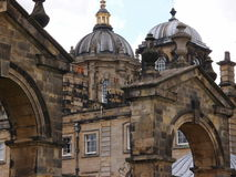 Stone arches and domes. Detailed stone work of arches and domes with decorative statues of Howard Castle in the Yorkshire province in England on a summer day royalty free stock photography