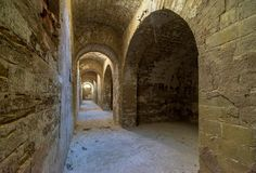 Stone arches in old fortess. Perspective, passageway, Totleben fortess near Kerch royalty free stock photo