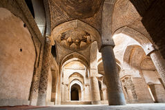 Stone arches of old persian mosque. ISFAHAN, IRAN: Stone arches of old persian mosque. Third largest city in Iran, Isfahan is example of Islamic culture royalty free stock photo