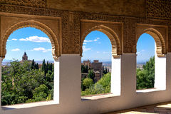 Stone arches in the world-famous Alhambra. In Granada with beautiful views of the fortress and Granada royalty free stock image