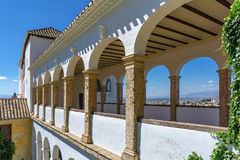 Stone arches in the world-famous Alhambra. In Granada with beautiful views of the fortress and Granada stock image