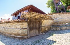 Stone architecture in Bulgarian Zheravna. Mountain eco-village Zheravna - Bulgarian national carpet center, rural tourism, national rural architecture and a stock photos