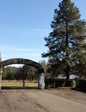 Stone archway at entrance to Masonic Cemetery, Canyonville, Oregon Royalty Free Stock Photography