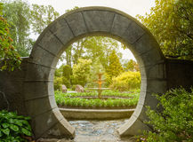 Stone archway in the garden Royalty Free Stock Photos