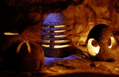 Stone Aroma Lamps. Picturesque photo of Stone Aroma Lamps in cave Stock Image