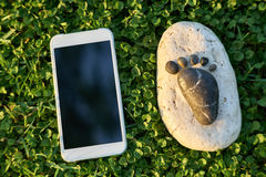 Stone arranged like footprints on the grass Stock Image