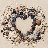 Stone arrangement as heart frame on the beach Stock Image