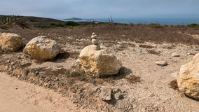 Stone art. Art made out of stones along the coast in Portugal Stock Photo