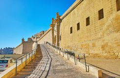 The way to Fort St Angelo, Birgu, Malta. The stone ascent to Fort St Angelo - one of the notable landmark of medieval Birgu Vittoriosa, Malta Royalty Free Stock Image