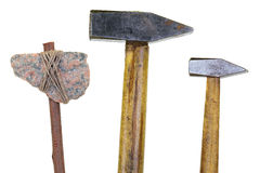 Stone ax and two hammers. Model of a stone ax and two old hammer. Object, isolated Royalty Free Stock Image