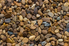 Stone backdrop. The backdrop of small brown stone texture royalty free stock image