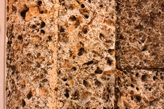 Stone background. Fund stone of a house, worn by humidity, rain, wind and weather royalty free stock photo