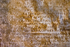 Stone background with antique inscriptions Stock Photos