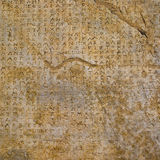 Stone background with antique inscriptions Stock Photo