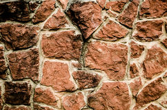 Stone background. Bright brown stone wall as a background royalty free stock image