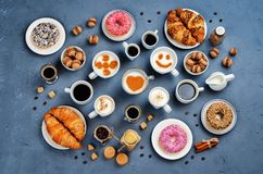 Stone background with different types of coffee and desserts to Stock Images