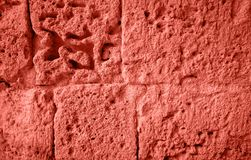Stone background in living coral color. Color of the year 2019 stock photography