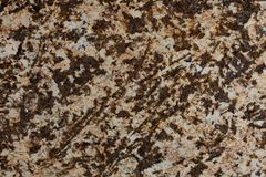 Stone background of mottled brown granite igneous rock. royalty free stock photography