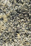 Stone Background of mottled granite igneous rock. Granite background with crystalline irregular pattern Stock Photos