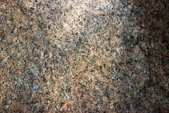 Stone Background of mottled granite igneous rock used for kitchen worktops etc.  Royalty Free Stock Images