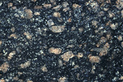 Stone Background of mottled granite igneous rock used for kitchen worktops etc. Black gray and white Stone Background of mottled granite igneous rock used for Royalty Free Stock Photography