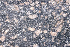 Stone Background of mottled granite igneous rock used for kitchen worktops etc.Inclusions of large light pinkish stones. Stone Background of mottled granite Royalty Free Stock Images