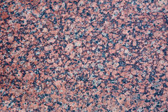 Stone Background of mottled red granite igneous rock. Texture Stock Photography