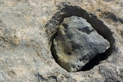 Stone background - mounted rock. Background: rock holes with water inside Royalty Free Stock Photography