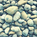 Stone background with round colorful pebbles from the sea beach. Digital illustration in vintage style. Stock Photos