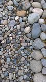 Stone Background. Background of stones of differing color arranged by size Royalty Free Stock Photo