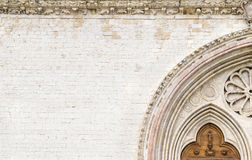 Stone background with an upper cathedral door details Stock Images