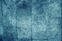 Stone Background Vertical tiles of mottled blue granite igneous rock used for kitchen worktops etc. Stone Background Vertical tiles of mottled blue granite Stock Image