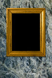 Stone background with vintage gold frame Stock Photo