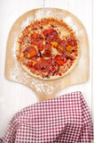 Stone baked pizza on wooden board Royalty Free Stock Photography