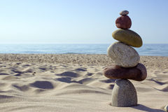 Stone balance. Pebble stack signifying harmony and balance by the Sea Stock Photos