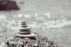 Stone balance. A small Zen out of a pile of stones on a rock,Stone balance Royalty Free Stock Image