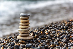 Stone balance in sunrise. Stones Balance in sunrise at sea in april Royalty Free Stock Images