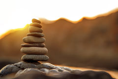 Stone balance in sunrise. Stones Balance in sunrise at sea in april Royalty Free Stock Photography