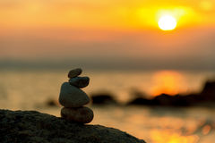 Stone balance in sunrise. Stones Balance in sunrise at sea in august Stock Photos