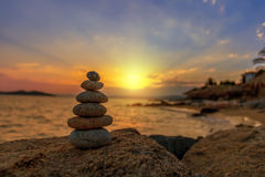 Stone balance in sunrise. Stones Balance in sunrise at sea in august Stock Image