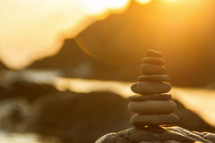 Stone balance in sunrise. Stones Balance in sunrise at sea in summer Royalty Free Stock Photos