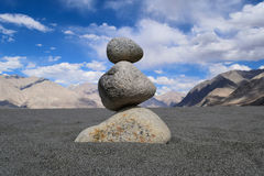 Stone balancing art at Nubra valley desert in Leh Royalty Free Stock Image