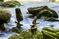 Stone balancing by the river. Stone balancing by the mountain stream stock image