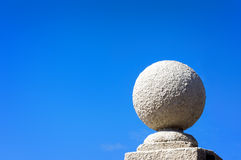Stone ball against blue sky Royalty Free Stock Photos