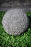 Stone ball on the grass Royalty Free Stock Image