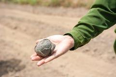Stone ball on the hand Stock Photos