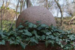 Stone ball with ivy ranks. The picture shows a stone ball with ivy ranks Royalty Free Stock Images