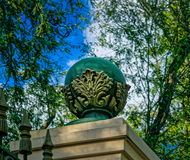 Stone ball on park fence pillar Stock Photos